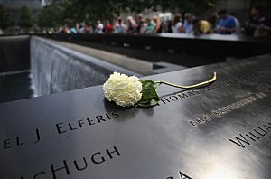 A flower lies atop names of victims at the 9/11 Memorial