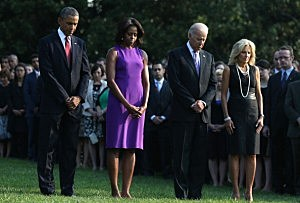 President Barack Obama, first lady Michelle Obama, Vice President Joseph Biden, his wife Jill Biden, and White House staff observe a moment of silence to mark the 12th anniversary of the 9/11 attacks