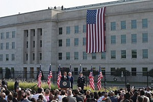 President Barack Obama delivers remarks during a ceremony in observance of the terrorist attacks of 9/11 with Defense Secretary Chuck Hagel (L) and Chairman of the Joint Chiefs of Staff Gen. Martin Dempsey at the Pentagon