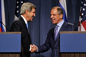Secretary of State John Kerry (L) and Russian Foreign Minister Sergey Lavrov shake hands as they speak to the press in Geneva