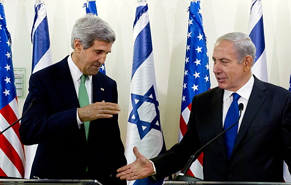 Secretary of State John Kerry (L) and Israeli Prime Minister Benjamin Netanyahu go to shake hands at the conclusion of their statements after their lengthly meeting