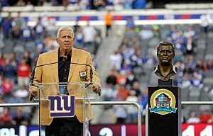 Hall of Fame head coach Bill Parcells speaks at a ceremony to receive his Hall of Fame Ring at halftime