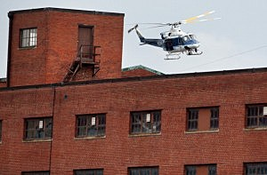 A police helicopter circles around above the Washington Navy Yard