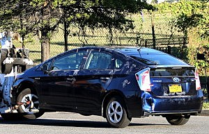 A blue Toyota Prius belonging to Aaron Alexis s towed away by Metro Police from the Washington Navy Yard