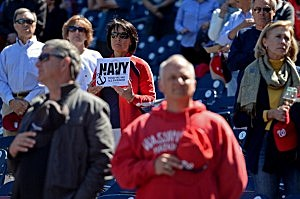 A fan holds up a sign during a moment of silence for the victims of the Navy Yard shooting before the Washington Nationals play the Atlanta Braves at Nationals Park