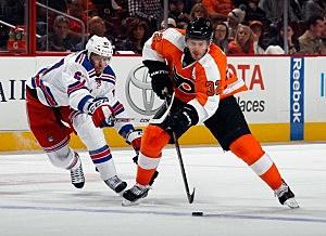 Mark Streit, Philadelphia Flyers; Benoit Pouliot, New York Rangers