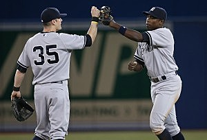 Alfonso Soriano of the New York Yankees celebrates their victory with Brendan Rya