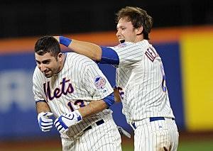 Matt den Dekker of the New York Mets congratulates his teammate Josh Satin