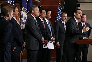 Sen. Ted Cruz (R-TX)(2nd-R) is flanked by House Repulicans while speaking about Obamacare during a news conference on Capitol Hill,