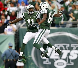 Wide receiver Stephen Hill #84 of the New York Jets celebrates his 51 yard touchdown catch with teammate Jeremy Kerley #11 against the Buffalo Bills