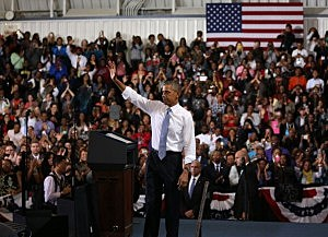 President Barack Obama waves to the crowd after speaking about health care at the Prince Georges Community College in Maryland