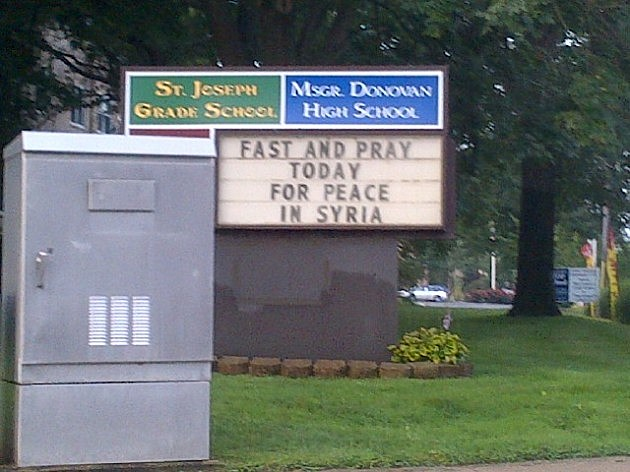 A sign outside Monsignor Donovan school in Toms River expresses the hope for a peaceful solution to the situation in Syria