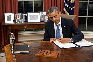 President Barack Obama signs H.R. 3210, Pay Our Military Act, which provides continuing appropriations for pay and allowances for members of the Armed Forces