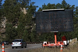 A sign along the highway near the entrance to Mount Rushmore National Memorial  warns visitors that the park is closed