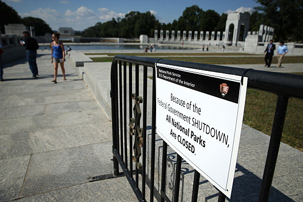 A sign shows that the World War II Memorial is closed during a government shutdown
