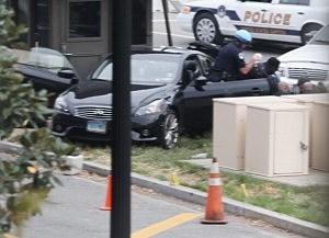 Police swarm around car driven by Miriam Carey on grass near the U.S. Capitol