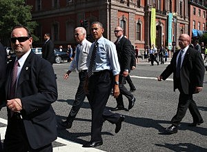 President Barack Obama and Vice President Joseph Biden walk down Pennsylvania Ave. to pick up lunch at the Taylor Gourmet Deli,