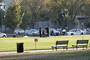 Police investigate the scene after a man set himself on fire at the National Mall
