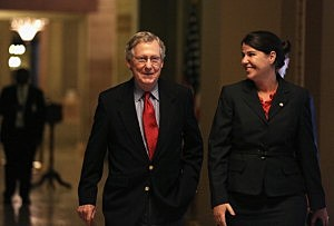 U.S. Minority Leader Senator Mitch McConnell (R-KY) walks towards the Senate Chamber with Secretary of the Minority Laura Dove