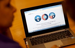 A message is seen on the computer indicating that there are too many visitors on the Affordable Care Act site
