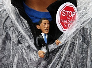 Teri McLain wears a U.S. President Barack Obama figure during a rally to urge Congress to end the government shutdown at the U.S. Capitol,