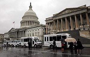 Members of the Senate Democratic caucus board buses to take them to the White House for a meeting with President Barack Obama