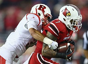 Damian Copeland #7 of the Louisville Cardinals runs with the ball as he is tackled Anthony Cioffi #31 of the Rutgers Scarlet Knights
