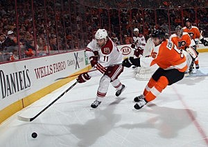 Martin Hanzal #11 of the Phoenix Coyotes is checked by Braydon Coburn #5 of the Philadelphia Flyers