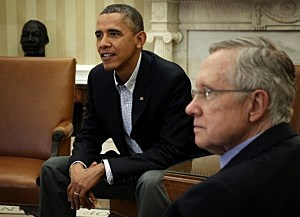 President Barack Obama (L) meets with Senate Democratic leadership, including Senate Majority Leader Sen. Harry Reid (D-NV) (R), to discuss the government shutdown