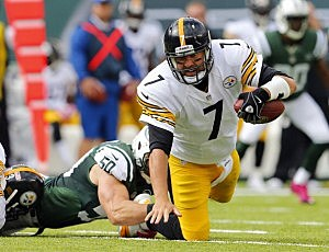 Ben Roethlisberger #7 of the Pittsburgh Steelers is sacked by Jets  linebacker Garrett McIntyre