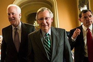 (L-R) U.S. Senate Minority Whip Sen. John Cornyn (R-TX), Senate Minority Leader Mitch McConnell (R-KY), and Sen. John Barrasso (R-WY) walk from McConnell's office to the Senate Chamber