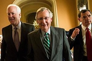 (L-R) U.S. Senate Minority Whip Sen. John Cornyn (R-TX), Senate Minority Leader Mitch McConnell (R-KY), and Sen. John Barrasso (R-WY) walk from McConnell's office to the Senate Chamber