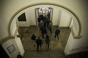 Reporters chase House Majority Leader Eric Cantor (R-VA) (not seen) as he leaves the Capitol Building