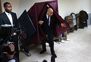 Newark Mayor Cory Booker emerges from the polling booth after casting his vote