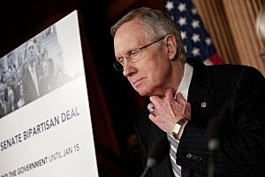.S. Senate Majority Leader Harry Reid (D-NV) speaks at a press conference after the U.S. Senate voted to fund the federal government and raise the debt limit