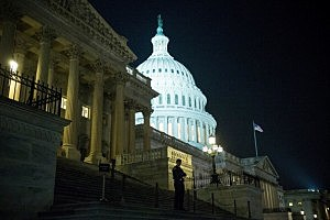 An officer stands on the steps of the House side of the Capitol building