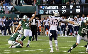 Kicker Nick Folk #2 of the New York Jets hits the game winning field goal in overtime against the New England Patriots at MetLife Stadium
