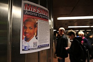 A poster for missing autistic 14-year-old named Avonte Oquendo hangs in a subway station