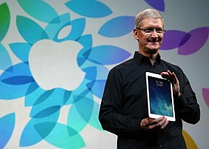 Apple CEO Tim Cook holds the new iPad Air during an Apple announcement in San Francisco