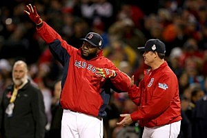 David Ortiz #34 of the Boston Red Sox celebrates after defeating the St. Louis Cardinals 8-1 in Game One of the 2013 World Series