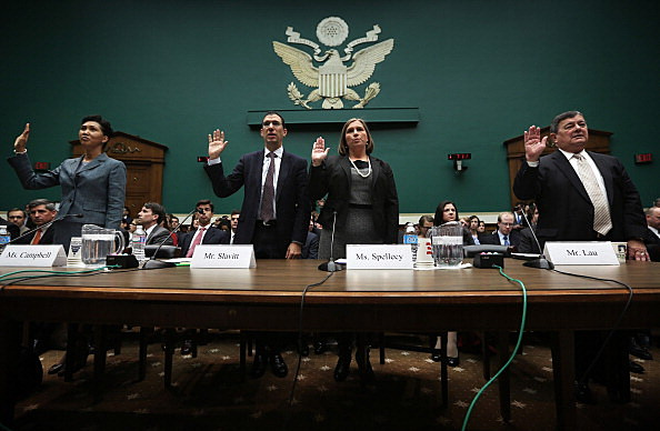 (L-R) Senior vice president of CGI Federal Cheryl Campbell, group executive vice president for Optum/QSSI Andrew Slavitt, corporate counsel for Equifax Workforce Solutions Lynn Spellecy, and program director for Serco John Lau are sworn in during a hearing on implementation of the Affordable Care Act before the House Energy and Commerce Committee