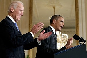 President Barack Obama (R) speaks at an event on immigration reform with Vice President Joe Biden (L) in the East Room of the White House