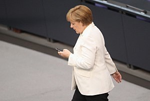 German Chancellor Angela Merkel checks her mobile phone during a session of the Bundestag in Berlin