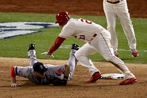 Allen Craig #21 of the St. Louis Cardinals gets tripped up by Will Middlebrooks #16 of the Boston Red Sox during the ninth inning
