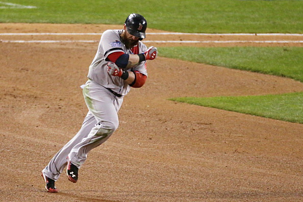 Jonny Gomes #5 of the Boston Red Sox runs the bases after hitting a three run home run