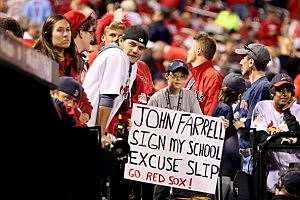 Red Sox fan holds up a sign for manager John Farrell