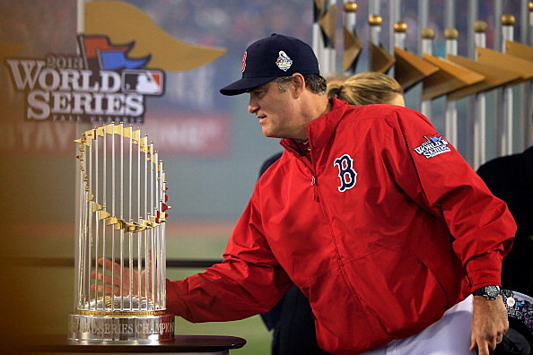 Manager John Farrell #53 of the Boston Red Sox holds the World Series trophy after defeating the St. Louis Cardinals