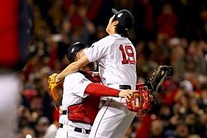 Koji Uehara #19 of the Boston Red Sox celebrates with David Ross #3