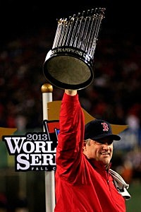 Manager John Farrell #53 of the Boston Red Sox holds up the World Series trophy