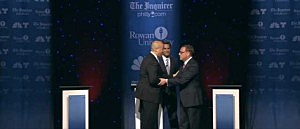 Cory Booker and Steve Lonegan shake hands at the end of their debate at Rowan University